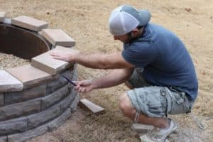 Walter in the building of his wood burning fire pit.